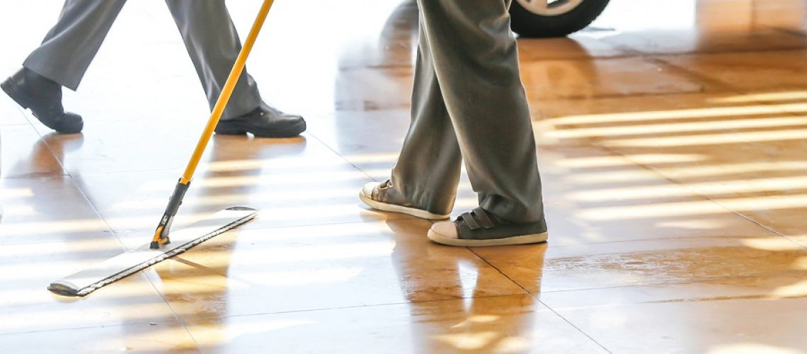Adult man mopping floor